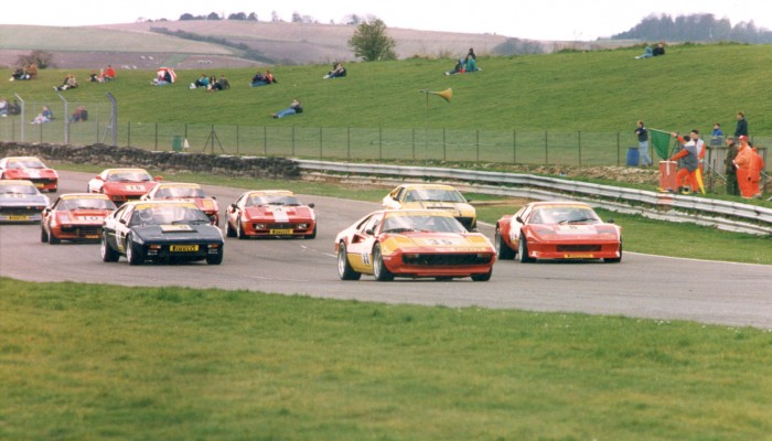 Robbie Sterling leads the field during the warm-up lap at Oulton